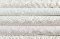 Stack of white textiles. For wedding dresses Royalty Free Stock Photography