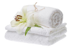 Stack of white towels with lily Royalty Free Stock Photo