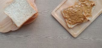 Stack of whole wheat bread and some peanut butter on top. royalty free stock image