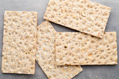 Stack of wholegrain crispy bread with sunflower, chia and sesame Royalty Free Stock Image