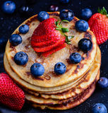 Stack of wholemeal pancakes with fresh fruits royalty free stock photography