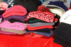Stack of winter hats at market stall Royalty Free Stock Photos