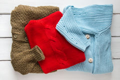 Stack of women's  sweaters and cardigans. Royalty Free Stock Image