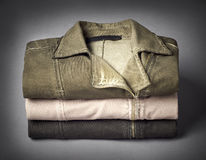 Stack of womens jackets on gray background Stock Photo