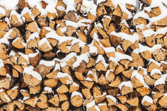 Stack of wood cut with snow Royalty Free Stock Images