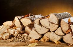 Stack of wood logs sitting on top of table Stock Photography