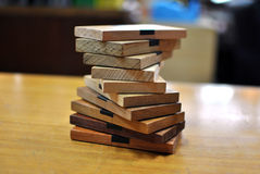Stack of wood. Many type of wood  laying in a table Royalty Free Stock Photography