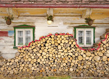 Stack of wood near old cottage Royalty Free Stock Images