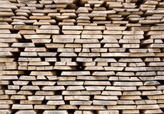 Stack of wood planks for construction buildings Stock Photos
