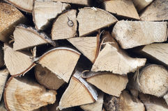 Stack of wood. The stock of firewood. Birch firewood. Close-up Stock Photo