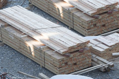 Stack of wooden beams and planks. Royalty Free Stock Photos