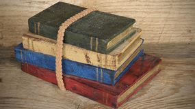 Stack of wooden books on wood background stock image