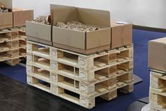 Pallets. Stack of wooden Euro pallets with boxes Stock Image