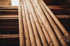 Stack of Wooden Fence Posts Close Up. Bound wooden cuttings Royalty Free Stock Images