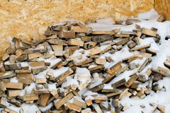 A stack of wooden firewood. Wooden firewood in winter Royalty Free Stock Photos