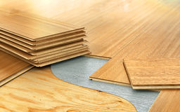 Stack of wooden laminate parquet. On a wooden blur background. 3d illustration Stock Images