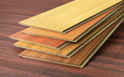 Stack of wooden laminate parquet on a wooden blur background. 3d illustration Royalty Free Stock Image