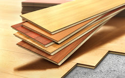 Stack of wooden laminate parquet on a wooden. Blur background. 3d illustration Stock Photo