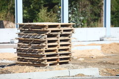 Stack of wooden pallets. Make a pathway Stock Image