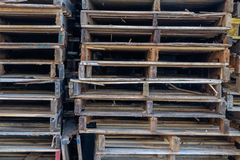 Stack of Wooden Pallets sitting on a working dock ready for outb Stock Photos
