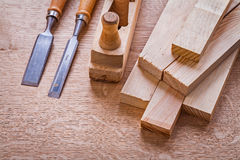 Stack of wooden planks chisels woodworkers plane Stock Image
