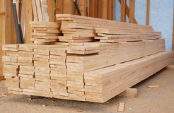Stack of wooden planks inside house Stock Photography