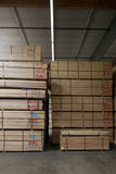 Stack of wooden plywood with markings in warehouse Stock Photography