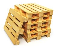 Stack of wooden shipping pallets. Logistics, cargo transportation and freight shipment concept: stack of wooden shipping pallets isolated on white background Royalty Free Stock Images