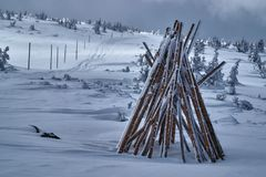 Stack of wooden stakes to mark winter hiking trails Royalty Free Stock Photography