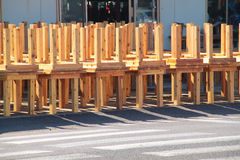 Disinfecting stack of wooden tables using natural sunlight. Stock Photos