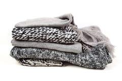 Stack woolen kläder Arkivbild