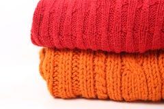 Stack woolen kläder Arkivbilder
