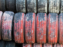 Stack of worn car tires. Stack of worn tires, symbolic photo for car tires, safety, accident risk royalty free stock photos