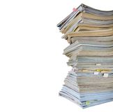 Stack of worn magazines and journals,isolated Royalty Free Stock Photography