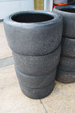 Stack of worn racing tyres Stock Image