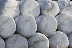 Stack of wrapped hay bales. Stack of plastic wrapped hay bales Stock Image