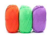 Stack of yarn skeins in red, green, purple colors Royalty Free Stock Images