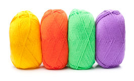 Stack of yarn skeins in red, yellow, green, purple colors Royalty Free Stock Images