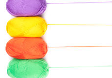 Stack of yarn skeins in yellow, orange, green, purple colors Stock Photos