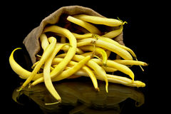 Stack of yellow beans in linen sack on black. Background Stock Photography