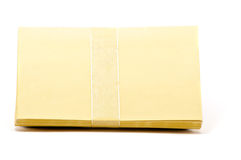 Stack of yellow greeting cards with ribbon. Over white stock images
