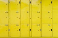 Stack of yellow lockers door at public locker service.  royalty free stock photo