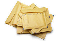 A stack of Yellow packaging envelope on white background Royalty Free Stock Photos