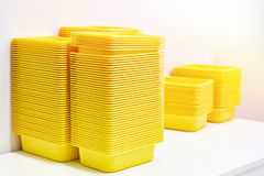 Yellow plastic food containers stock images