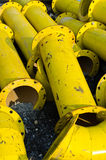 Stack of yellow steel pipe. Pile of old yellow steel pipe Royalty Free Stock Images