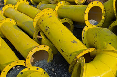 Stack of yellow steel pipe. Pile of old yellow steel pipe Stock Image
