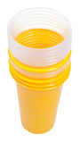 Stack of yellow and transparent plastic glasses Stock Images
