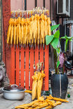 Stack of yellow umbrellas for sale at a stall Royalty Free Stock Image