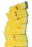 Stack of yellow watermelon slices on white isolated Stock Photo