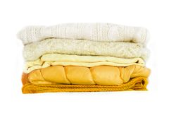 Stack yellow winter clothes isolated on white background. stock images
